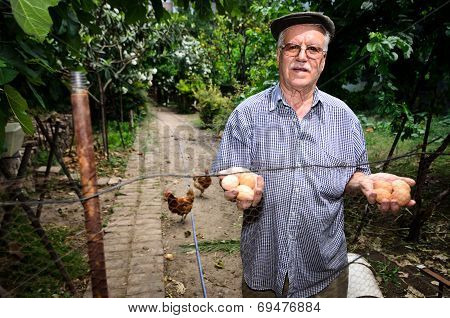 Old man holding eggs