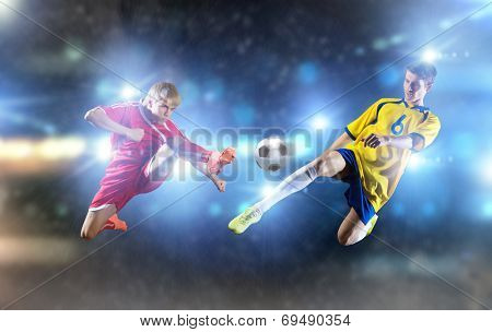 Two young football players struggling for ball poster