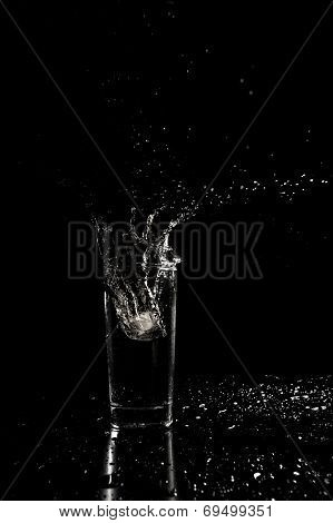 Water Splashing Out Of A Glass