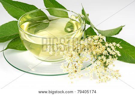Glass cup with elder tea