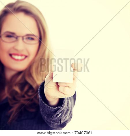 Businesswoman in suit holding blank empty businesscard.