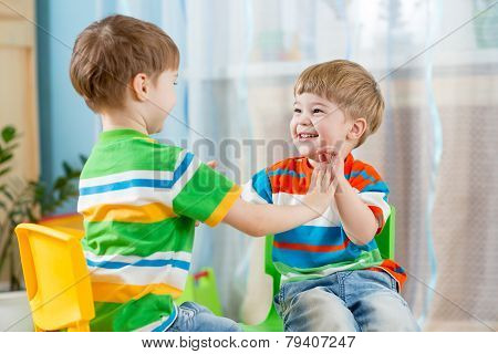 two friends children boys play together indoor