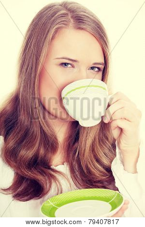 Young attractive corpulent blond woman drinking coffee