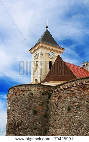 Old clock tower in Palanok Castle (or Mukachevo Castle Ukraine built in 14th century) poster