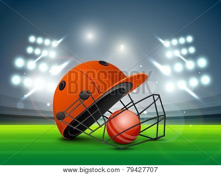 Red helmet with ball shining in night stadium lights for Cricket sports concept.