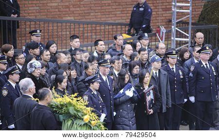 Widow of Wenjian Liu with NYPD flag