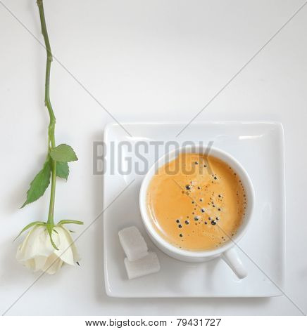 Top view of  coffee cup with white rose