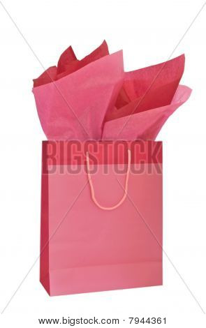 Pink recycled gift bag with tissue paper isolated on white background