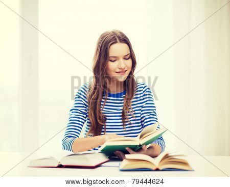 education and home concept - happy smiling student girl with books