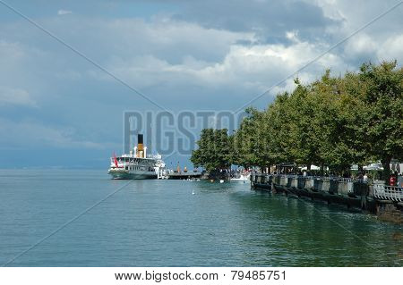 Vevey Switzerland - August 16 2014: Passenger ferry at quay in Vevey at Geneve lake in Switzerland. Unidentified people visible. poster