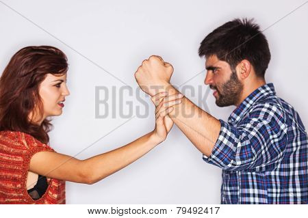Closeup Of A Man Fist Held Back By His Girlfriend