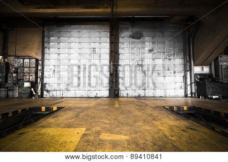 Dirty, Oily Door Of The Bus Garage