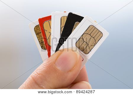 Hand With Phone Sim Cards