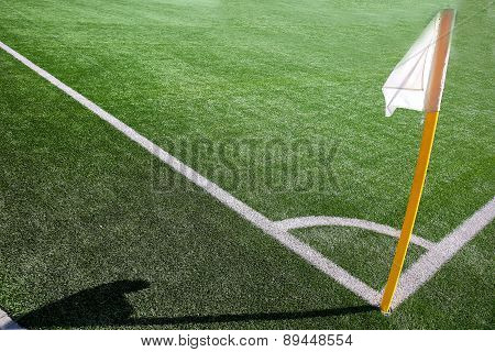 Flag on the corner of football field with shadow at sunny day poster