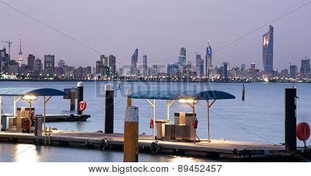 Kuwait City skyline with 372 m high The Liberation Tower which contains a revolving restaurant, radio and other telecommunications offices poster