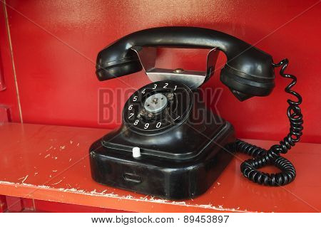 Black Telephone Set In Red Phone Box