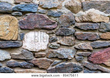 masonry multi-colored natural stone, symbol of texture, background, individuality
