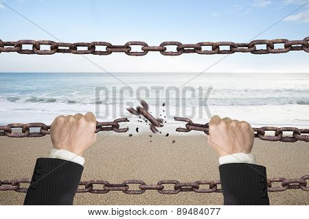 Rusty Iron Chains Broken Off By Hands With Sky Sea