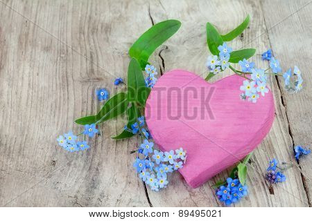 Pink Heart Shape Made Of Wood With Forget-me-not Flowers On A Wooden Background