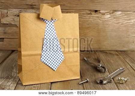 Fathers Day shirt and tie gift bag on wood