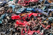 old cars were scrapped in a trash compactor. scrap iron and scrapping premium for car wrecks poster