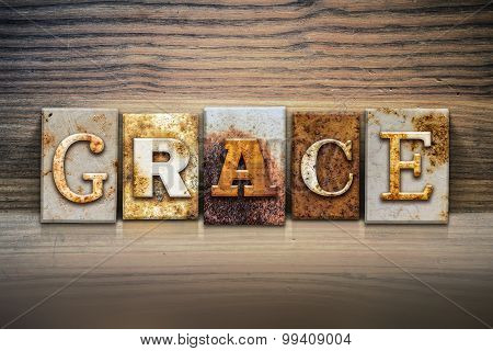 "The word ""GRACE"" written in rusty metal letterpress type sitting on a wooden ledge background. poster"