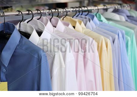 Mens Shirts On Hangers In A Retail Store
