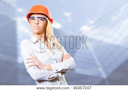 Sexy bossy blonde girl in helmet with folded hands