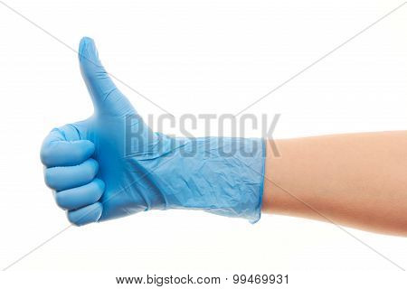 Doctor's hand in blue surgical glove showing thumbs up sign