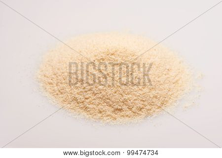 Pile of semolina croup on the white