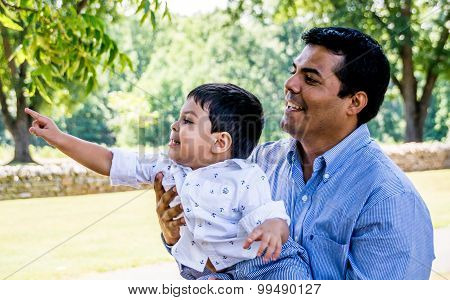 Latino Father And Son Outside