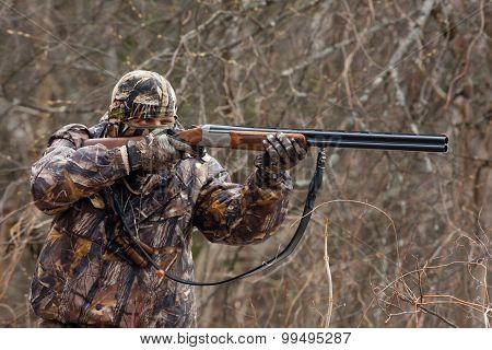 Hunter Takes Aim From A Gun