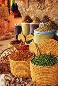 Natural dying products and spices on a market in Marrakech, Morocco. poster