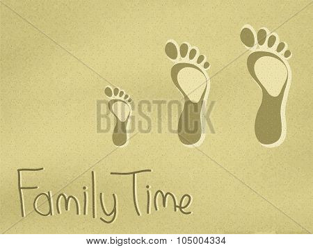 Family footprints on the sand