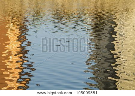 natureframe of golden sinuous weaves background