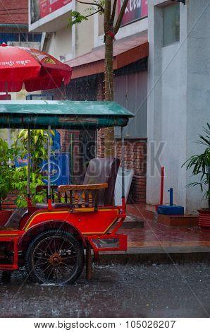 Tuktuk motocycle during rain monsoon in Kampot