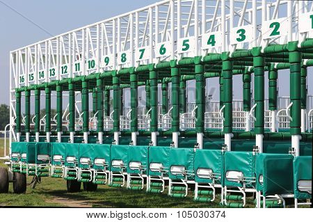Green Colored Start Gates For Horse Races On The Racetrack