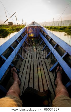 POV sitting on a lila boat Inle Lake