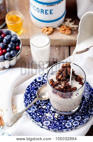 Molasses glazed oatmeal granola with milk