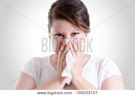 Middle Age Lady Blowing Her Nose Too Hard