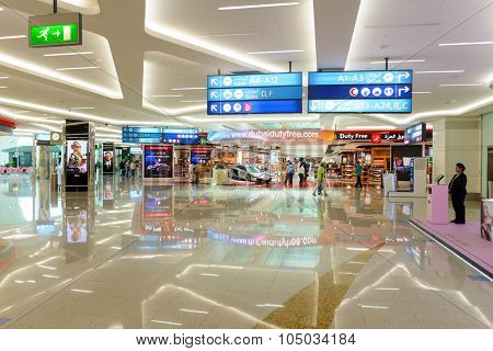 DUBAI, UAE - JUNE 04, 2014: retail area in the concourse A. Dubai Duty Free is the company responsible for the duty-free operations at Dubai International Airport