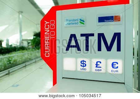 DUBAI, UAE - APRIL 18, 2014: ATM in Dubai international Airport. Dubai Airport is the primary airport serving Dubai and is the world's busiest airport by international passenger traffic