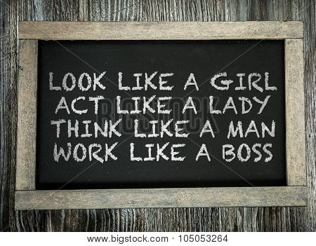 Look Like a Girl Act Lika a Lady Think Like a Man Work Like a Boss written on chalkboard