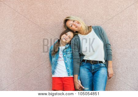 Portrait of happy mother with daughter