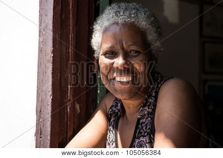 Brazilian woman smiling from the window