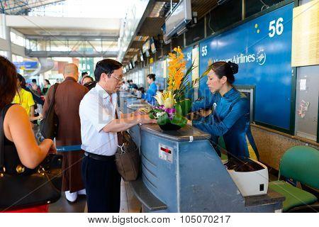 HANOI, VIETNAM - MAY 11, 2015: passengers check-in in Noi Bai International Airport. Noi Bai International Airport is the largest airport in Vietnam.