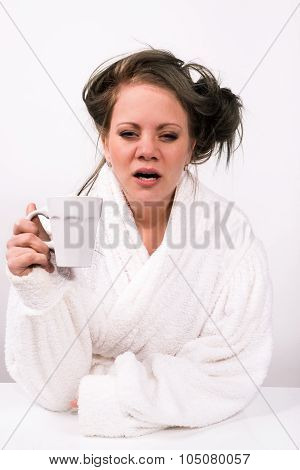 Very Tired Young Woman Holding A Cup Of Coffee