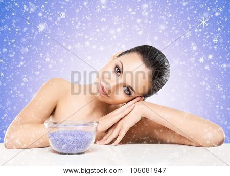 Portrait of young, beautiful and healthy woman with a mineral salt