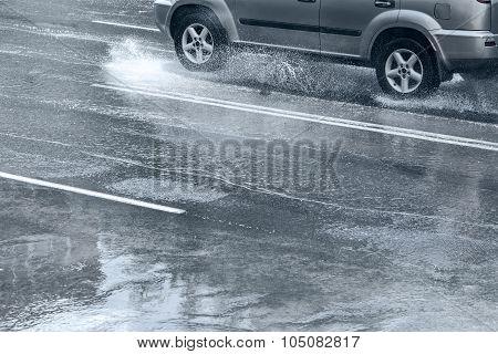 Car Rides On Water Splashing On The Road