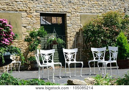 Four cast iron white garden chairs